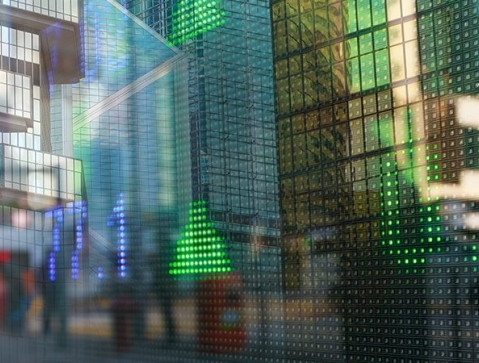 Stock tickers with city in reflection